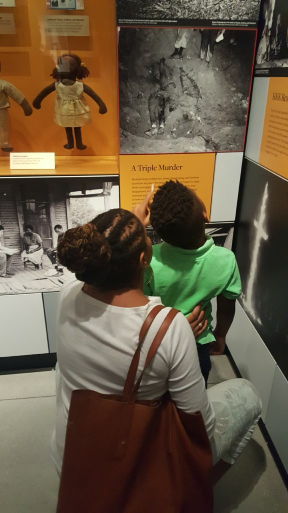 A mom teaching her young son about Chaney, Goodman, and Schwerner -- Mississippi civil rights workers who were murdered.
