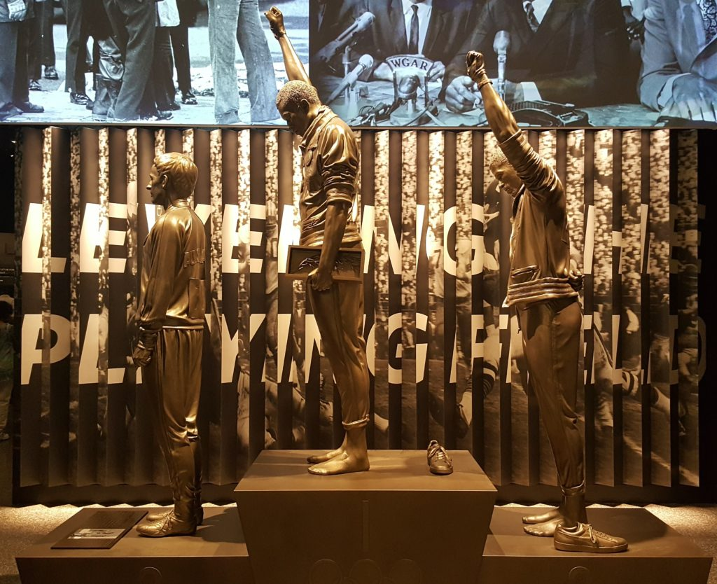 A statue of gold medalist Tommie Smith and bronze medalist John Carlos raising their fists in Black Power salute during the 1968 Summer Olympics in Mexico City.