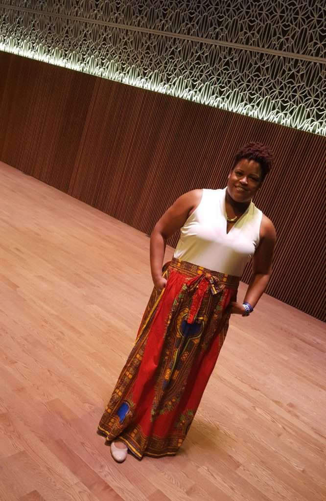 "Standing on Oprah's stage (inside the museum's ""Oprah Winfrey Theater"")"